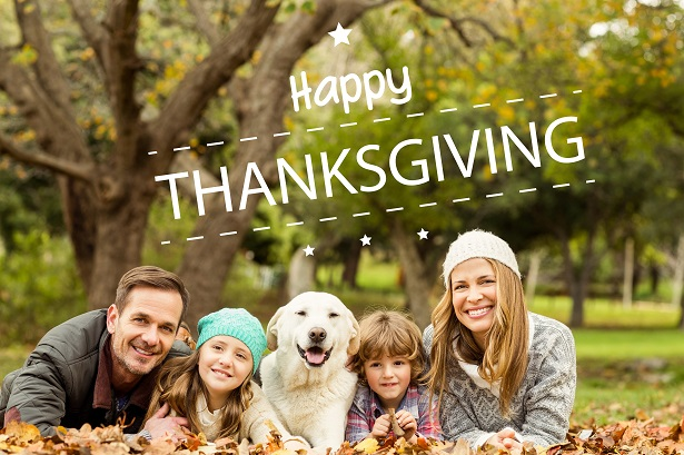 Happy thanksgiving against young family with a dog